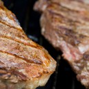Grilling steaks on the grill nice cuts of meat close up shot shallow DOF
